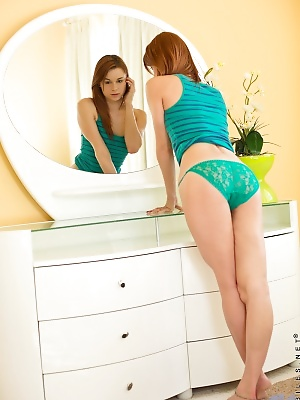 Sexy Sage Evans admires her perfect curves in the mirror