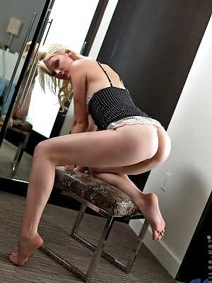 Blonde babe flaunts her tasty ass as she plays with her vibrator